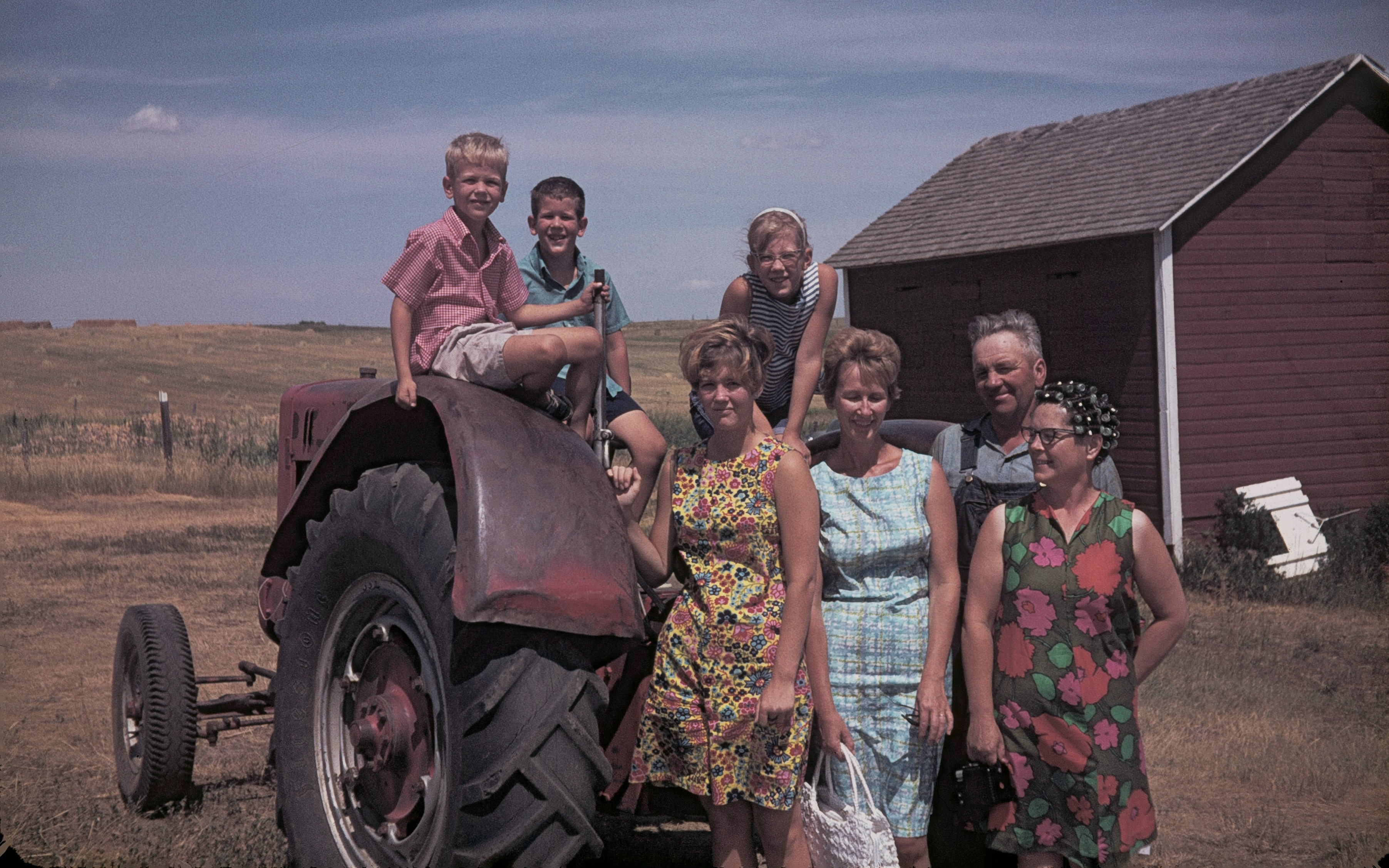Image: A family picture with a tractor.