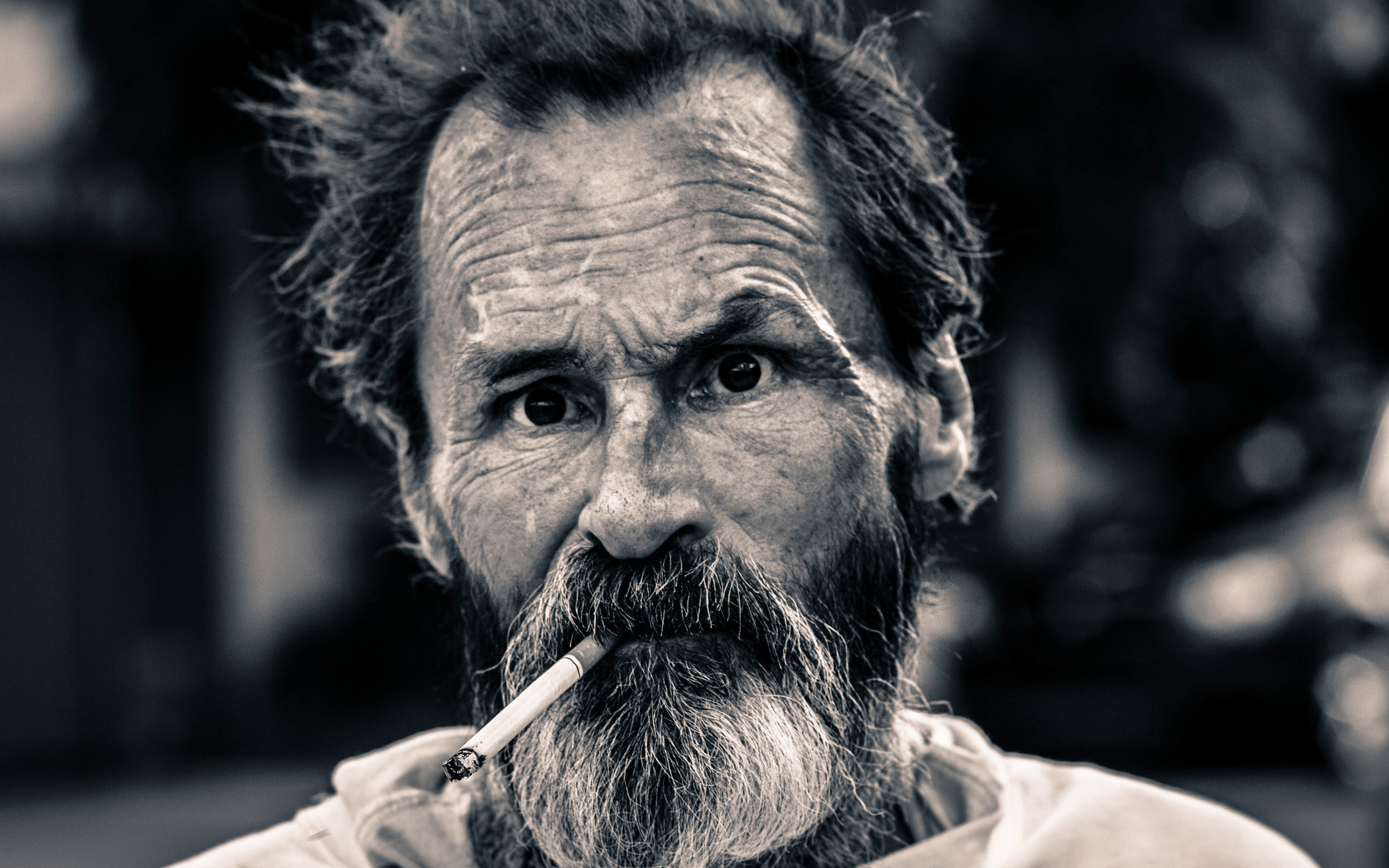 Image: Picture of a homeless man with cigarette in his mouth.