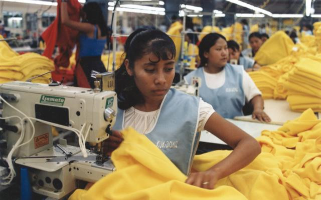 Image: Picture of women and girls working in a sweatshop.
