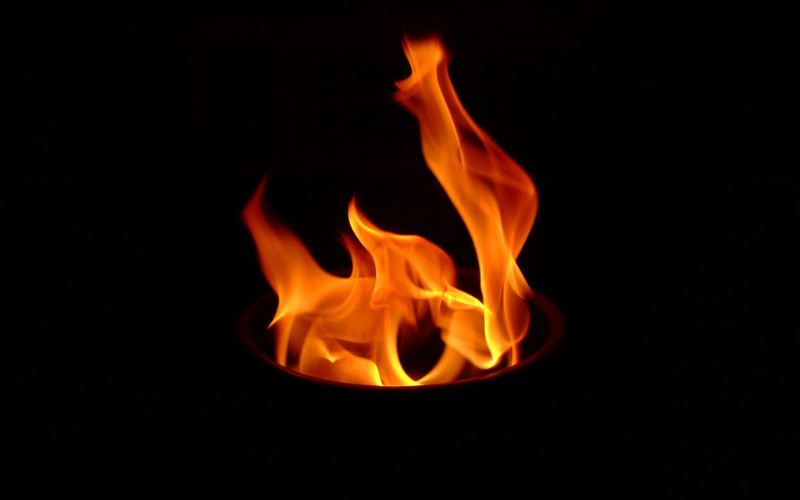 Image: A fire in darkness.