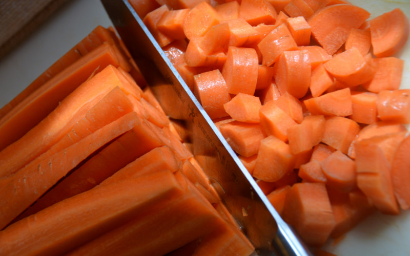 Image: A picture of carrots being chopped.
