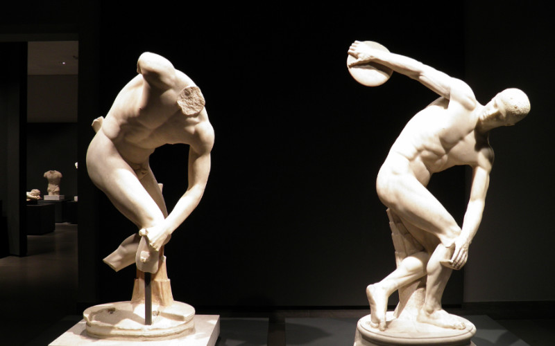 Image: Statues of Greek Olympians performing the disc throwing.