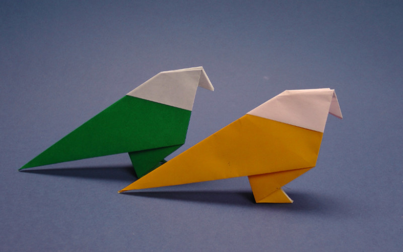 Image: Two origami birds, one yellow and one green.