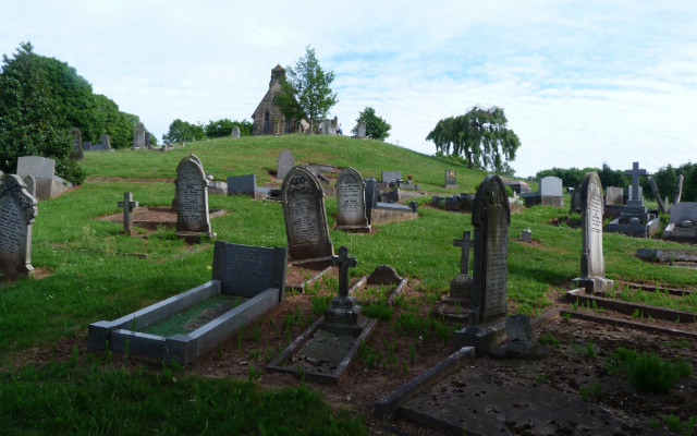 Image: A graveyard with old headstones.