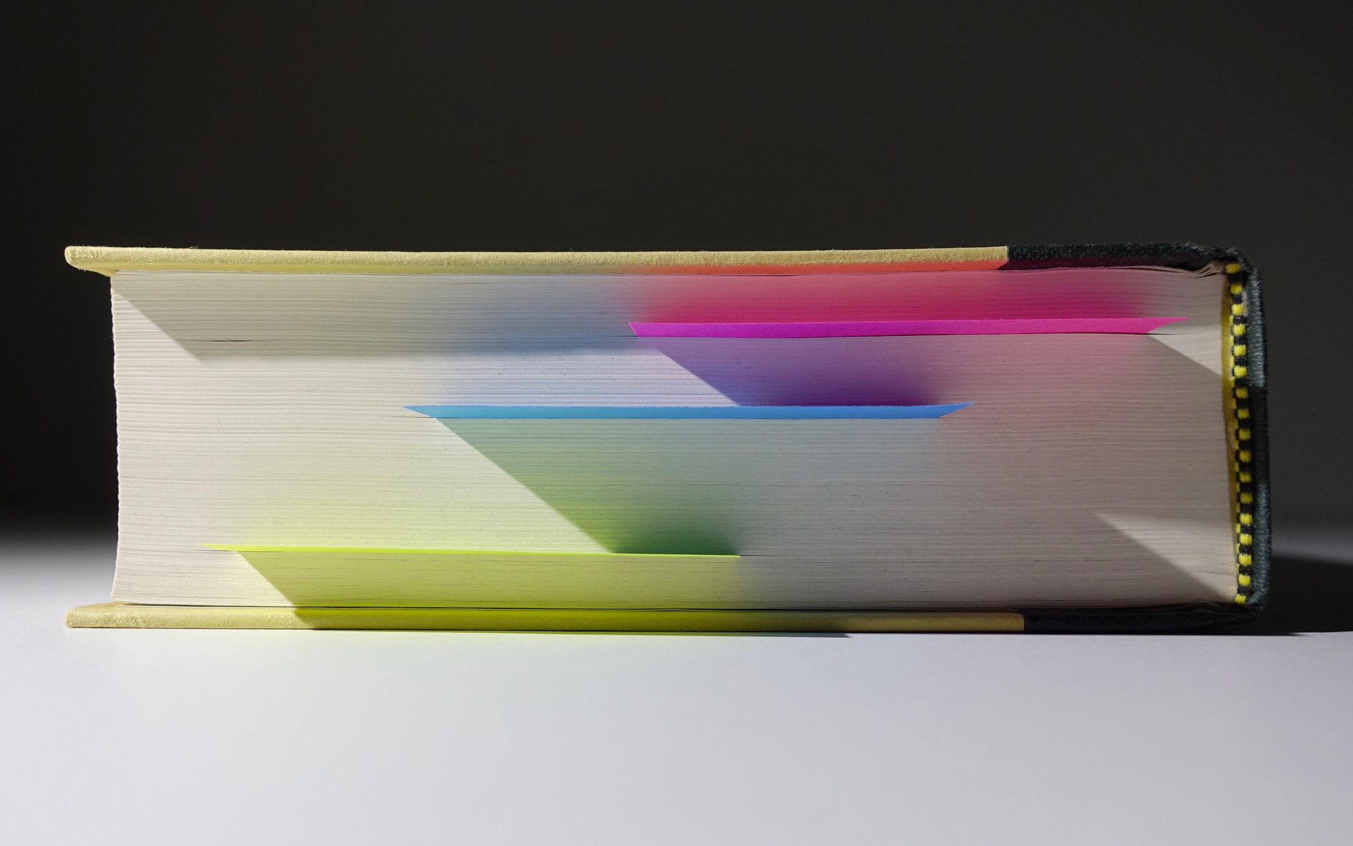 Image: A book with post-it notes marking pages.
