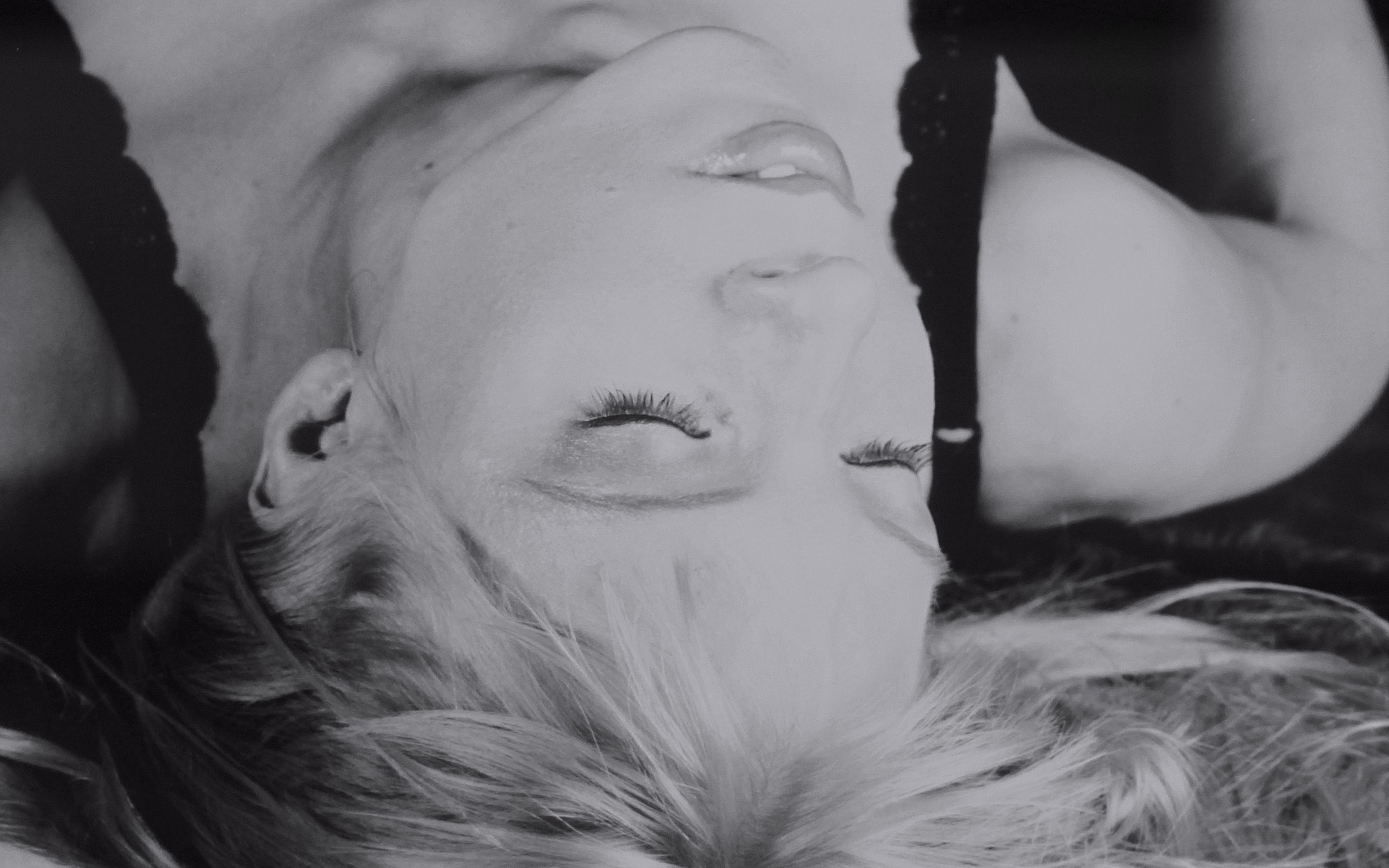 Image: Suvi Mahonen laying down, eyes closed, black and white.
