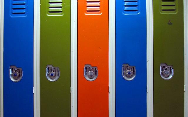 "Image: A series of lockers colored blue, green, and red, Titled ""Individuality"" provided by Loozrboy is licensed under CC BY-SA 2.0"