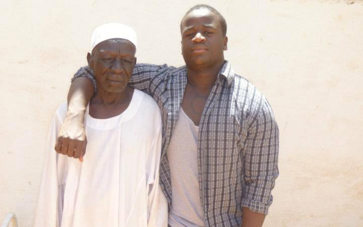 Image: A photo of author Muhammad Shareef with his arm slung over his grandfather